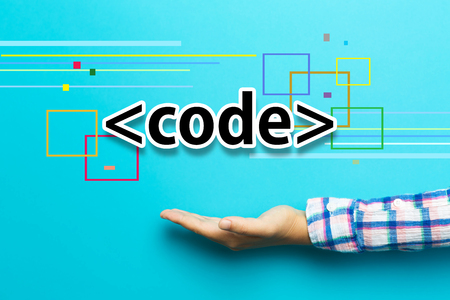 Code concept with hand on blue background Stock Photo
