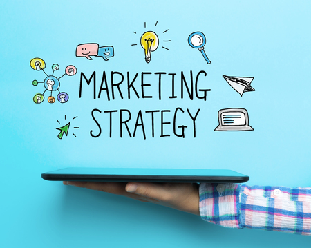 marketing strategy: Marketing Strategy concept with a tablet on blue background