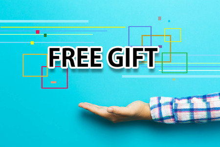 free hand: Free Gift concept with hand on blue background Stock Photo