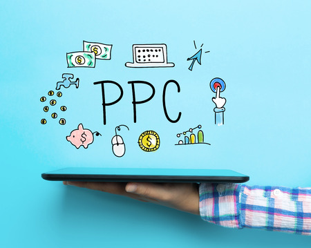 PPC concept with a tablet on blue background