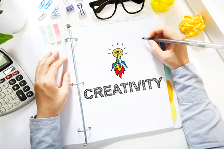 creativity concept: Person drawing Creativity concept on white paper in the office
