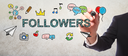 followers: Businessman drawing Followers concept with a marker