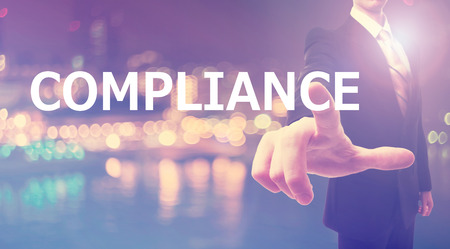 compliant: Compliance concept with businessman on blurred city background Stock Photo