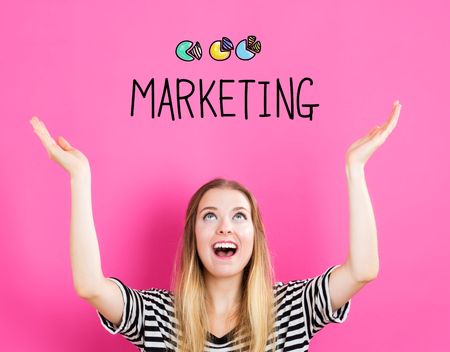 Marketing concept with young woman reaching and looking upwards
