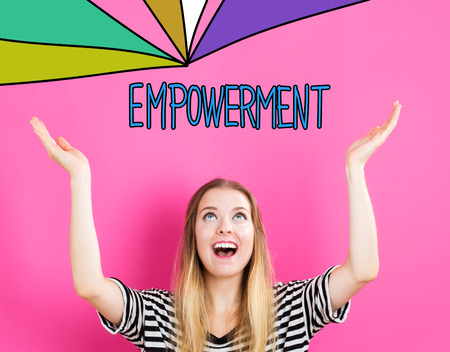 empowerment: Empowerment concept with young woman reaching and looking upwards