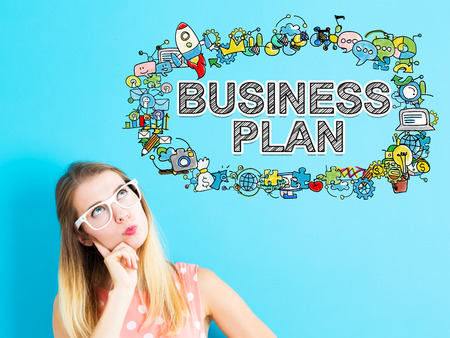 thoughtful: Business Plan concept with young woman in a thoughtful pose Stock Photo