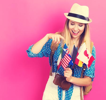 deciding: Young traveling woman deciding where to travel next