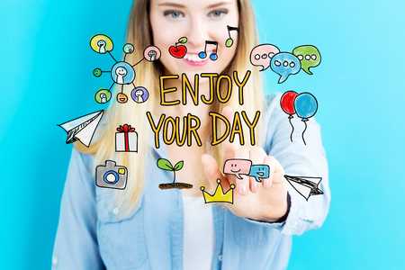 your point: Enjoy Your Day concept with young woman on blue background Stock Photo