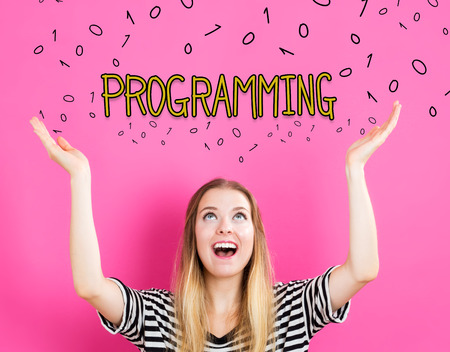 Programming concept with young woman reaching and looking upwards Stock Photo