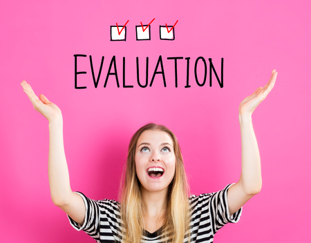 Evaluation concept with young woman reaching and looking upwards Stock Photo