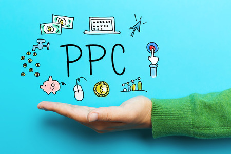 PPC concept with hand on blue background