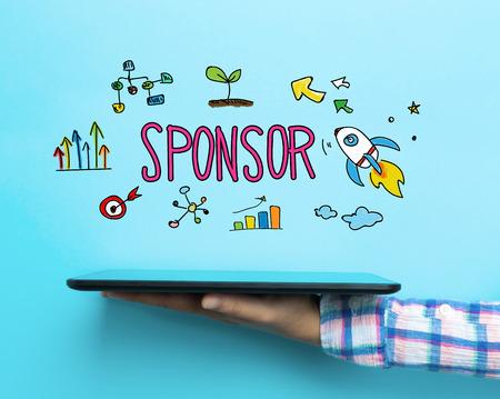 sponsoring: Sponsor concept with a tablet on blue background