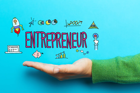 Entrepreneur with hand on blue background Фото со стока