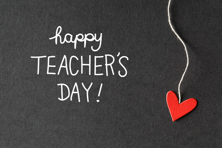 Happy Teachers Day message with handmade small paper hearts  Stock Photo