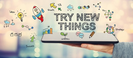 try: Try New Things concept with man holding a tablet computer