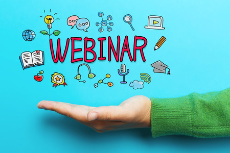 Webinar concept with hand on blue background