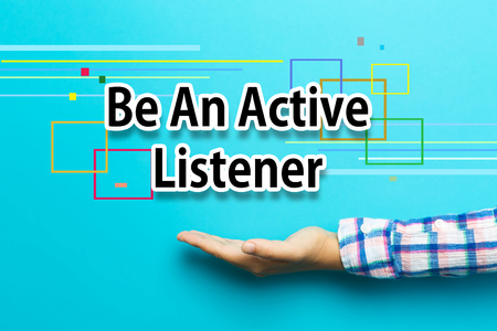 Be An Active Listener concept with hand on blue background Stock Photo