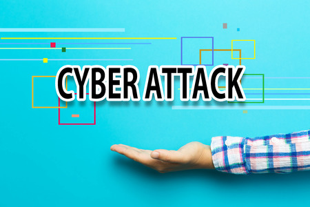cyber attack: Cyber Attack concept with hand on blue background
