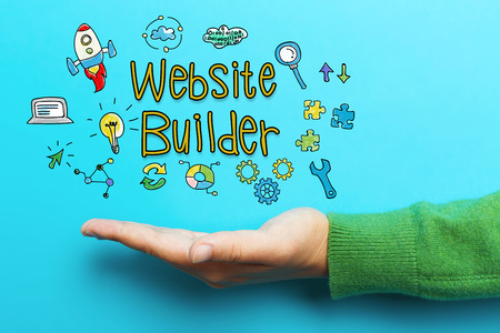 Website Builder concept with hand on blue background