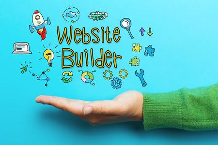 Website-Erbauer-Konzept mit der Hand auf blauem Hintergrund Standard-Bild - 63824618