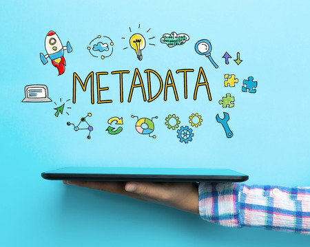 metadata: Metadata concept with a tablet on blue background Stock Photo