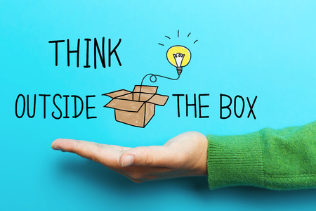 outside the box: Think Outside The Box concept with hand on blue background