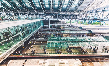 bullet train: Commuters boarding trains inside the massive Osaka Station in Osaka, Japan Stock Photo