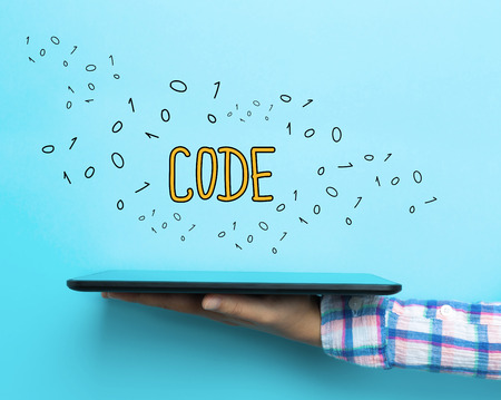 Code concept with a tablet on blue background