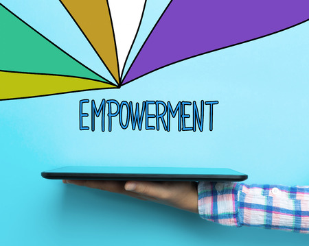 Empowerment concept with a tablet on blue background