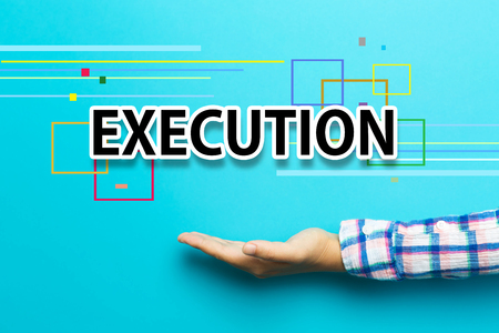 execution: Execution concept with hand on blue background