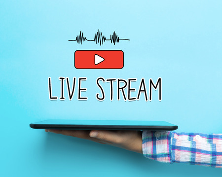 Live Stream concept with a tablet on blue background Stock Photo