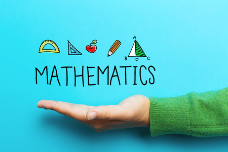 Mathmatics concept with hand on blue background Stock Photo