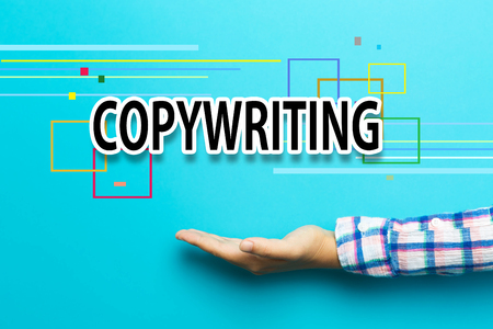 copywriting: Copywriting concept with hand on blue background