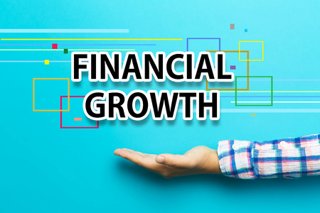 financial growth: Financial Growth concept with hand on blue background