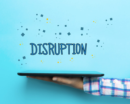 disruption: Disruption concept with a tablet on blue background Stock Photo