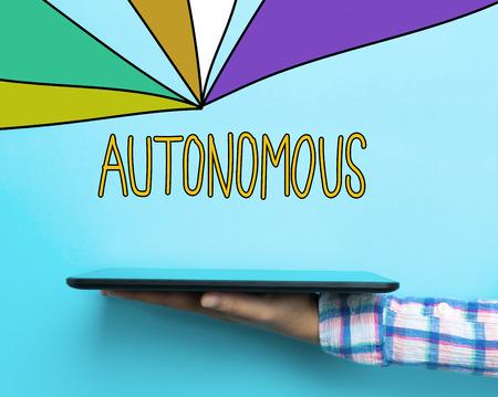 Autonomous concept with a tablet on blue background