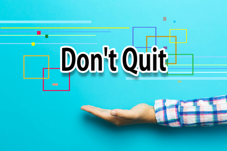 don't: Dont Quit concept with hand on blue background