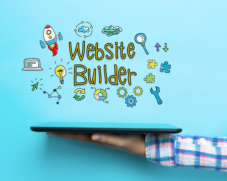Website Builder concept with a tablet on blue background