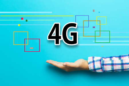 4G concept with hand on blue background
