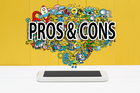 Pros and Cons concept with smartphone on yellow wooden background