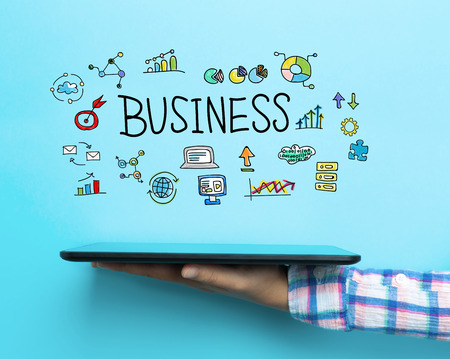 Business concept with a tablet on blue background