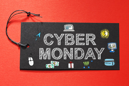 paper tag: Cyber Monday text on a black tag on a red paper background Stock Photo