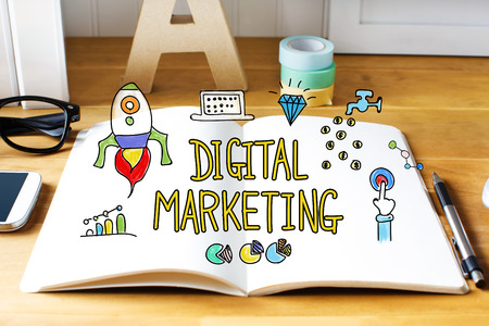 digital media: Digital Marketing concept with notebook on wooden desk Stock Photo