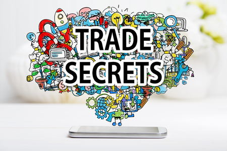 Trade Secrets concept with smartphone on white table