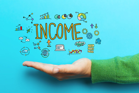 Income concept with hand on blue background