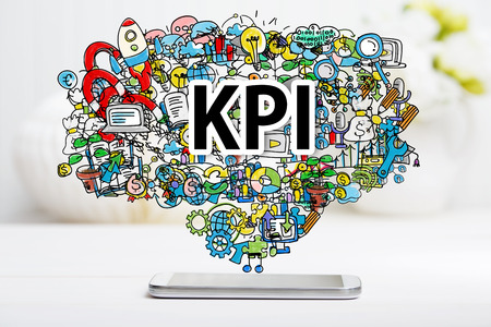 kpi: KPI concept with smartphone on white table Stock Photo