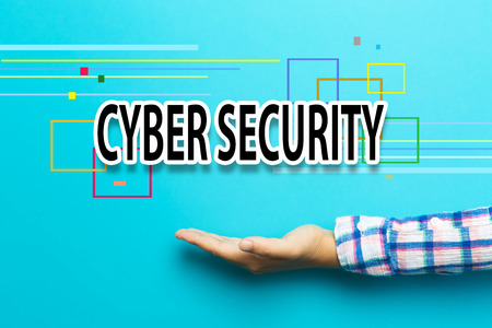 Cyber Security concept with hand on blue background Stock Photo