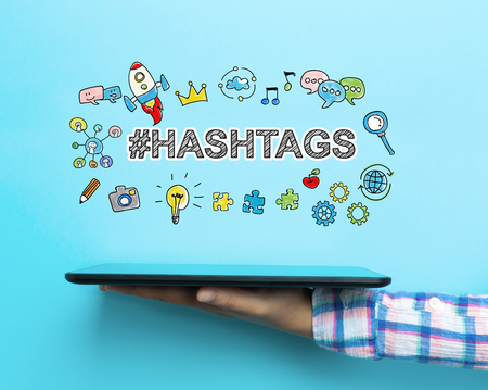 Hashtags concept with a tablet on blue background Stock Photo