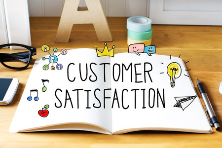 Customer Satisfaction concept with notebook on wooden desk Stock Photo