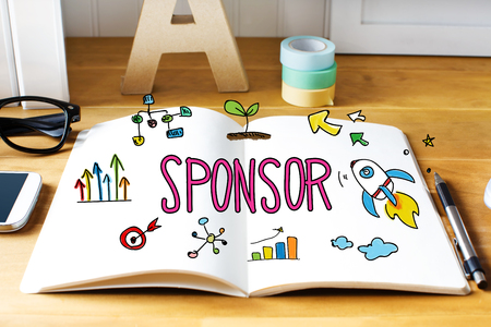 sponsoring: Sponsor concept with notebook on wooden desk Stock Photo